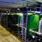 Water treatment tanks on power plant — Stock Photo