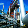 Industrial zone, Steel pipelines and valves against blue sky — Stock Photo #6931976