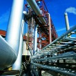 Industrial zone, Steel pipelines and valves against blue sky — Stockfoto