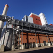 Stock Photo: Modern industrial factory against blue sky