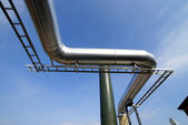 Industrial zone, Steel pipe-lines on blue sky — Stock Photo