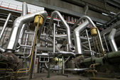 Different size and shaped pipes at a power plant — ストック写真