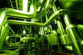Industrial zone, Steel pipelines in green tones — Stock Photo