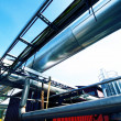 Industrial zone, Steel pipelines and valves against blue sky — Stock Photo #6947891