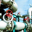 Stock Photo: Industrial zone, Steel pipelines and valves against blue sky