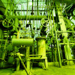 Industrial zone, Steel pipelines and valves in green tones — Stock Photo