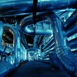 Pipes, tubes, machinery and steam turbine at a power plant — Stock Photo