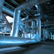 Pipes, tubes, pumps and steam turbine at a power plant — Stock Photo