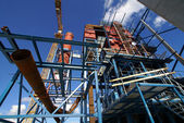 Cranes and beams on construction of industrial factory — Stock Photo