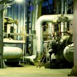 Pipes, tubes, machinery and steam turbine at a power plant — Stock Photo #6950482