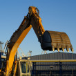 Hydraulic excavator at work. Shovel bucket against blue sky — Stock Photo #6952085