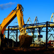 Hydraulic excavator at work. Shovel bucket against blue sky — Stock Photo #6952157