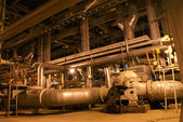 Pipes, machinery, tubes and pumps at a power plant — Stock Photo