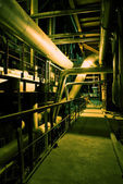 Pipes, tubes, machinery and chimney at a power plant — Stock Photo