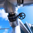 Industrial zone, Steel pipelines and valves against blue sky - ストック写真