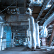 Stock Photo: Pipes, tubes, machinery and steam turbine at a power plant
