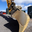 Hydraulic excavator at work. Shovel bucket against blue sky — Stock Photo #7488811