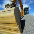 Stock Photo: Hydraulic excavator at work. Shovel bucket against blue sky