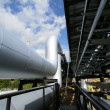 Stock Photo: Industrial pipelines on pipe-bridge against blue sky