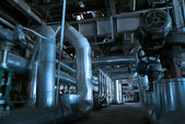 Pipes, tubes, machinery and steam turbine at a power plant — Stok fotoğraf