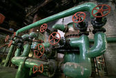 Wheels on industrial piping — Stock Photo