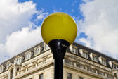 Yellow urban lamppost — Stock Photo