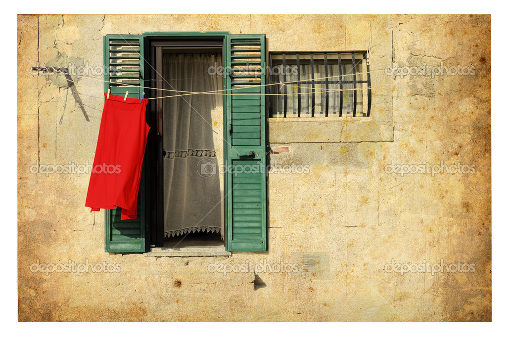 Out, caressed by the Mediterranean sun, is drying a red robe. — Stock Photo #6857854