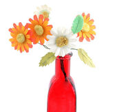 Bottle and flower — Stock Photo