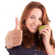 Young woman with green apple and showing thumb up — Stock Photo