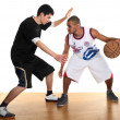 Постер, плакат: Two sportsmen playing basketball