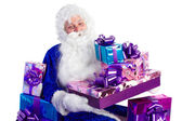 Santa Claus in blue with presents — Stock Photo