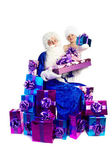 Santa Claus in blue with lots of presents — Stock Photo