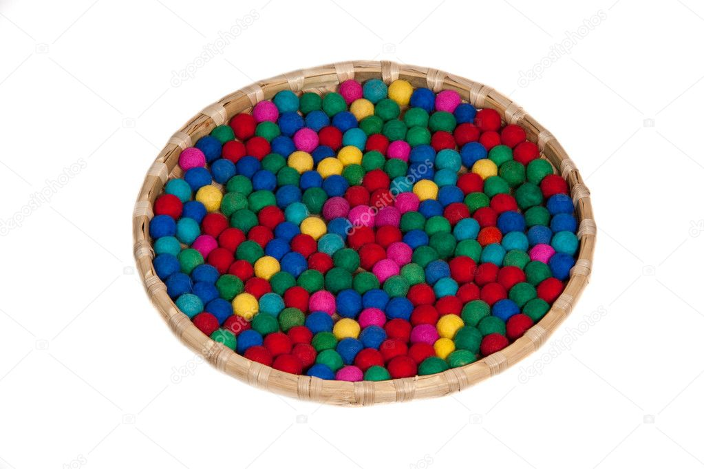Colorful bobbles in the basket with white background — Stock Photo #6957497