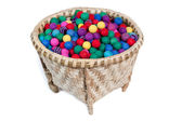Colorful bobbles in the basket — Stock Photo