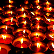 Liquid candles in the dark Shree Boudhanath temple — Stock Photo