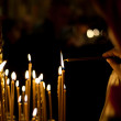 Prayer lightning candle in church — Stok fotoğraf