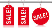 Sale label tags hanging down — Stock Photo