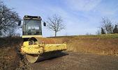 Veículo de construção compactador amarelo — Foto Stock