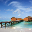 Bridge leading to over water bungalows — Stock Photo