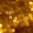 Golden christmas lights background — Stock Photo