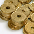 Pile of golden coins isolated — Stock Photo #6984568