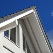 Modern building with tiled roof — Stock Photo #6984640