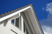 Modern building with tiled roof — Stock Photo