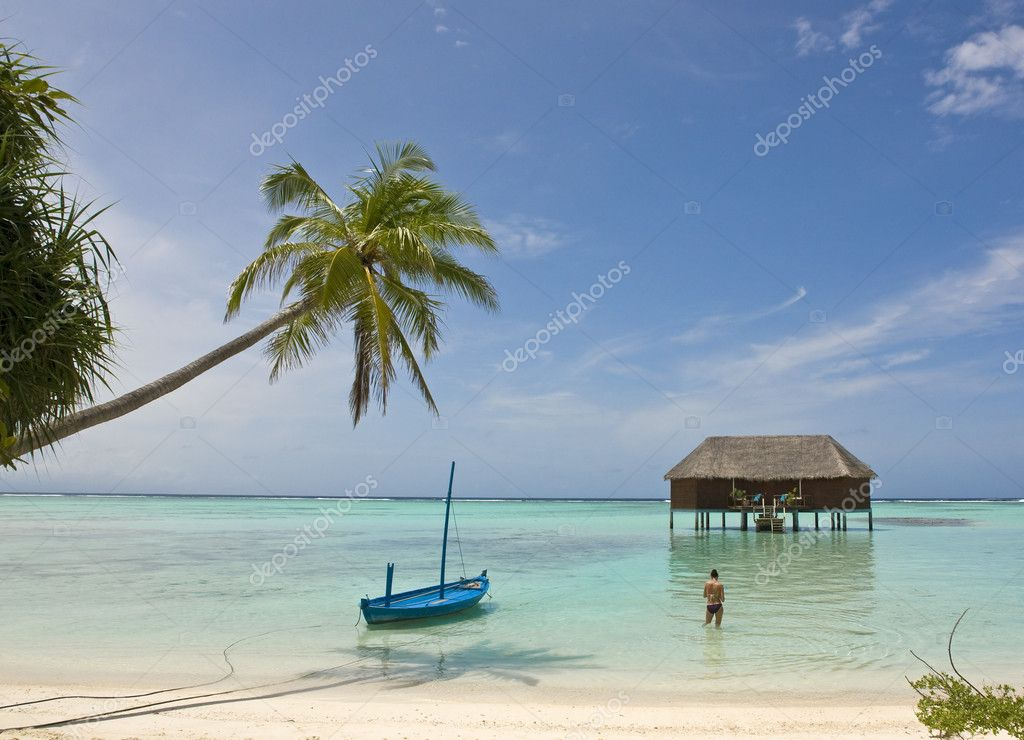 Blue boat anchoring on tropical beach — Stock Photo #6994273