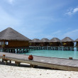 Water villas over blue ocean — ストック写真