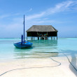 Blue boat on tropical beach — Stock Photo #7104738