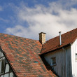 The roof of the house under the blue sky  — Stock Photo