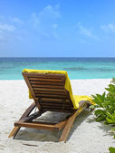 Beach chairs and table on ocean front — Stock Photo
