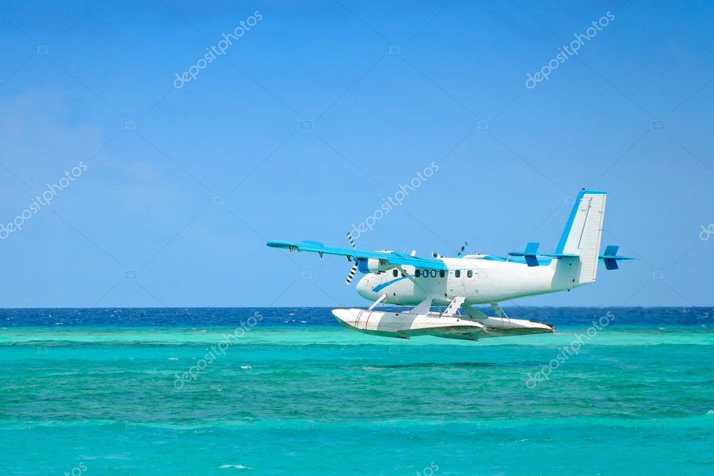 Seaplane landing on the ocean  Stock Photo #7214609