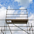 Foto Stock: Scaffolding erected for building new houses